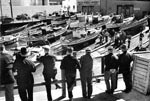 A row of onlookers view the Montereys hauled for maintenance on the skidways at the Jones Street extension of Fisherman's Wharf, circa 1935. Photograph Karl Kortum. Copyright by Jean E. Kortum.